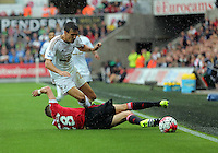Pictured: Morgan Schneiderlin of Manchester United fouls Jack Cork of Swansea Sunday 30 August 2015<br />