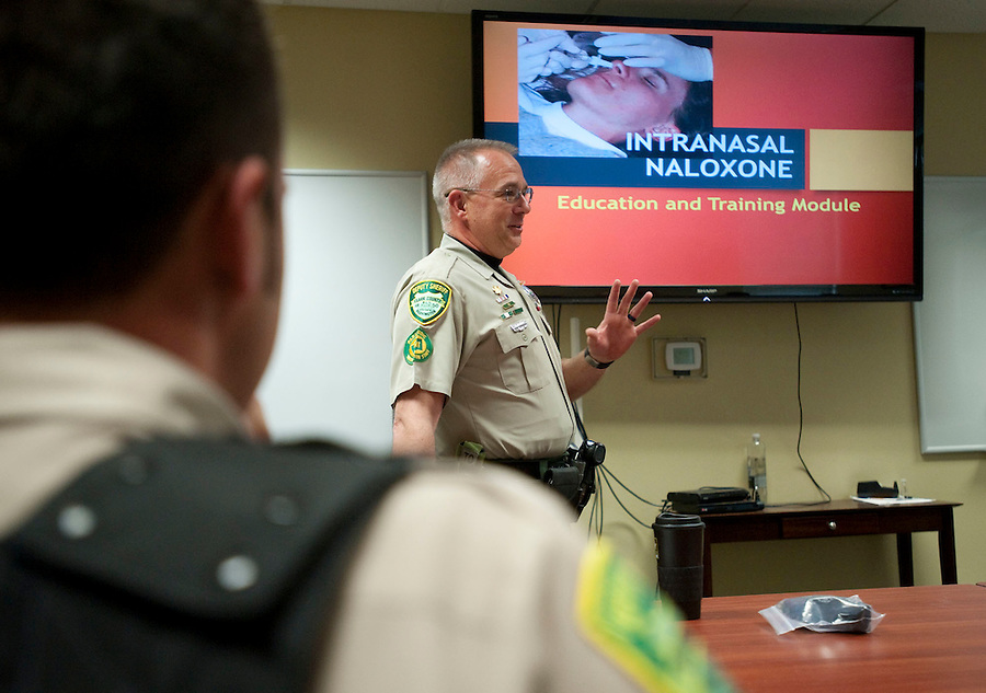 Deputy sheriff John Shields teaches at a training session to learn how to use and administer the inhalant naloxone, Wednesday May 18, 2016. (Photo by Natalie Behring/The Columbian)