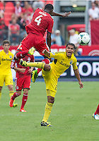 July 27, 2013: Columbus Crew forward Jairo Arrieta #25 and Toronto FC defender Doneil Henry #4 in action during an MLS regular season game between the Columbus Crew and Toronto FC at BMO Field in Toronto, Ontario Canada.