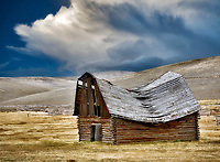 Fallen down barn with Thunderclouds. Montana.