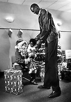 Golden State Warrior center 7'7&quot; Manute Bol towers over Santa &amp; child at Christmas party in Oakland,Ca<br />