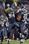 Seattle Seahawks defensive end Anthony Hargrove celebrates with corner back Brandon Browner after he intercepted a pass against the Washington Redskins in the second quarter at  CenturyLink Field in Seattle, Washington on November 27, 2011. ©2011 Jim Bryant Photo. All Rights Reserved.