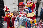Covent Garden, London, UK. 11 May 2014. The festival starts with a procession around the streets of Covent Garden.  Young puppeteers with Punch & Judy figures. The Covent Garden May Fayre and Puppet Festival takes place at St Paul's Church.