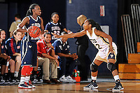 21 January 2012:  FIU guard Jerica Coley (22) defends FAU guard Takia Brooks (22) in the second half as the Florida Atlantic University Owls defeated the FIU Golden Panthers, 50-49, at the U.S. Century Bank Arena in Miami, Florida.