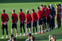 Wales players observe the November 11th armistice silence ahead of a Wales Training Session at Cardiff City Stadium, Cardiff, Wales on 11 November 2016. Photo by Mark  Hawkins.