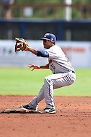 Fort Myers Miracle second baseman Aderlin Mejia (13) waits for a throw on a pickoff attempt during a game against the Charlotte Stone Crabs on June 24, 2014 at Charlotte Sports Park in Port Charlotte, Florida.  Fort Myers defeated Charlotte 7-6.  (Mike Janes/Four Seam Images)