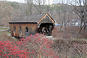 The Baltimore Covered Bridge during the autumn months in Springfield, Vermont USA.