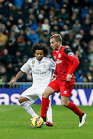 Marcelo of Real Madrid and Gerard Deulofeu during La Liga match between Real Madrid and Sevilla at Santiago Bernabeu Stadium in Madrid, Spain. February 04, 2015. (ALTERPHOTOS/Caro Marin) /NORTEphoto.com