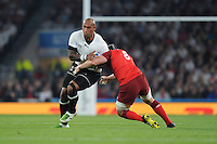 Nemani Nadolo of Fiji is tackled by Ben Morgan of England during Match 1 of the Rugby World Cup 2015 between England and Fiji - 18/09/2015 - Twickenham Stadium, London <br /> Mandatory Credit: Rob Munro/Stewart Communications