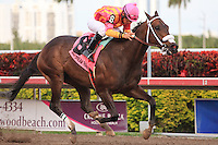 Force Freeze with jockey Paco Lopez winning the Gulfstream Park Sprint Championship(G2). Gulfstream Park, Hallandale Beach Florida.