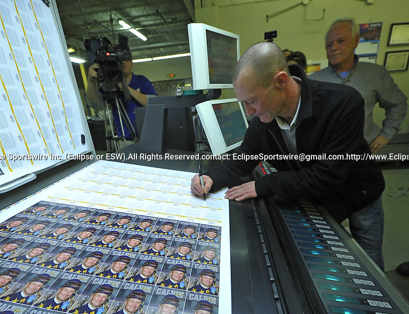 Jan. 07, 2013 - Little Rock, Arkansas, U.S -  Calvin Borel signs a sheet of trading cards that are being printing to commemorate his 5000th career victory which will take place at Oaklawn Park during the 2013 season. (Credit Image: © Jimmy Jones/Eclipse/ZUMAPRESS.com)