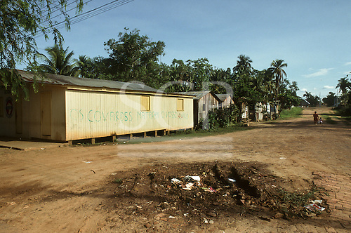 "Xapuri, Acre State, Brazil. Poor house with ""The cowards killed our Chico"" painted on the wall in a poor street."