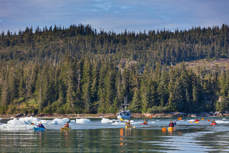 Tourists aboard the MV Discovery kayak in Western Prince William Sound, southcentral, Alaska.