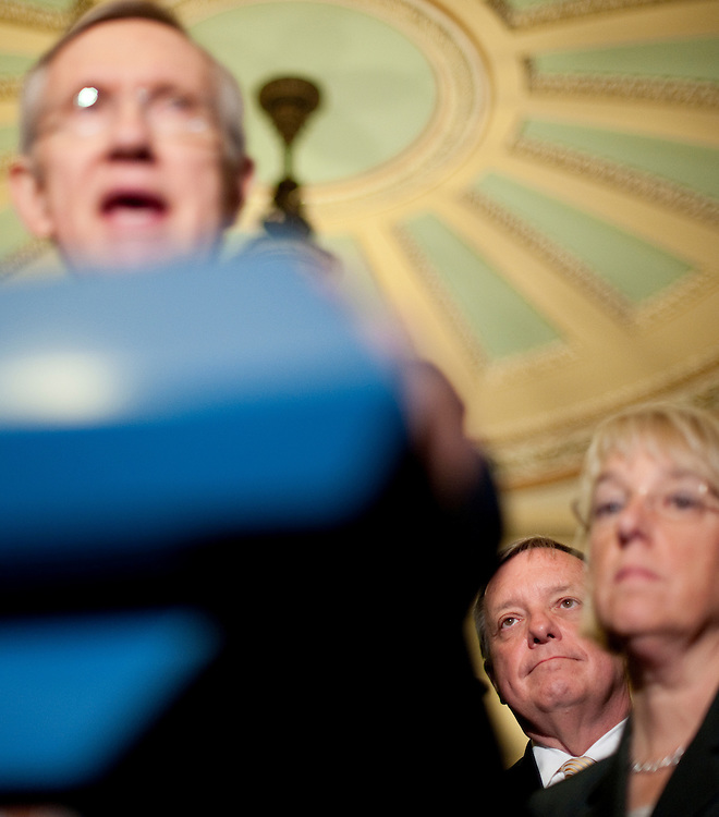 UNITED STATES - JUNE 23: Sen. Richard Durbin, D-Ill., center, listens along with Sen. Patty Murray, D-Wash., as Senate Majority Leader Harry Reid, D-Nev., speaks to reporters following a Senate Democrats' caucus meeting about Republicans leaving the debt talks on Thursday, June 23, 2011. (Photo By Bill Clark/Roll Call)
