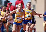 SIOUX FALLS, SD - MAY 2:  Carley Carper from South Dakota State University takes the baton from teammate Gina Fritz in the 4x100 Friday afternoon at the Howard Wood Dakota Relays. (Photo by Dave Eggen/Inertia)