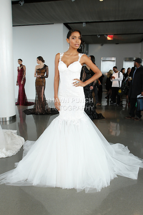 "Model poses in a bridal gown from the Galia Lahav Haute Couture Spring 2015 ""La Dolce Vita Bridal"" collection, during New York Bridal Fashion Week, on April 11, 2014."