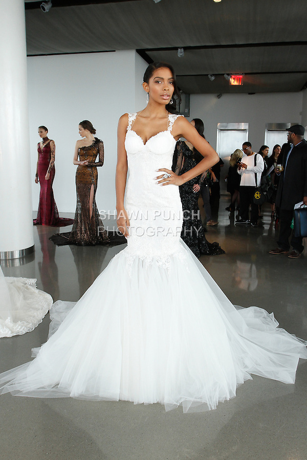 """Model poses in a bridal gown from the Galia Lahav Haute Couture Spring 2015 """"La Dolce Vita Bridal"""" collection, during New York Bridal Fashion Week, on April 11, 2014."""