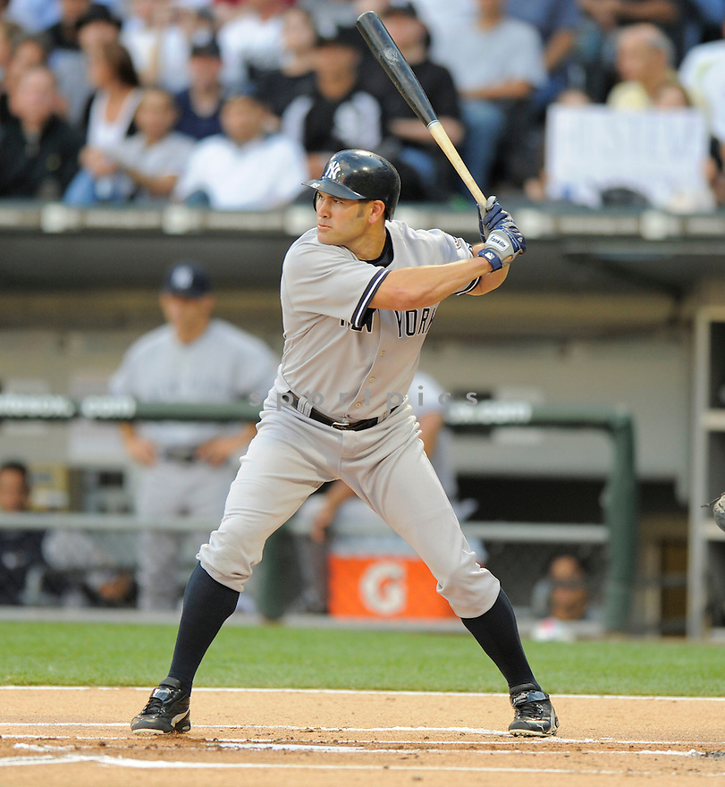 JOHNNY DAMON,  of the New York Yankees  in action  during the Yankees game against the Chicago White Sox.  The  Yankees beat the White Sox 10-5 in Chicago, Illinois on July 31, 2009...David Durochik