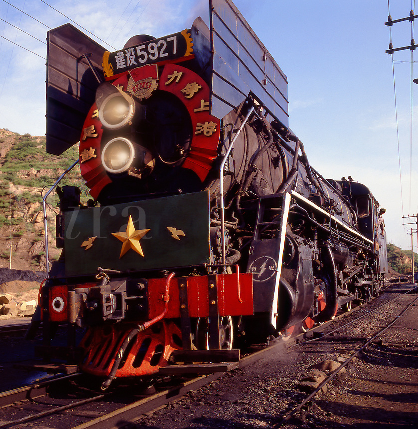 Chinese mainline steam railway engine working in coal mine and burning cheaply available fuel.