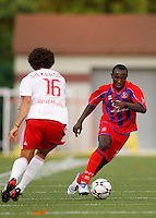 Crystal Palace midfielder Matthew Mbuta (12) is marked by New York Red Bulls defender John Gilkerson (16). Crystal Palace FC USA of Baltimore (USL2) defeated the New York Red Bulls (MLS) 2-0 during a Lamar Hunt US Open Cup third round match at Lawrence E. Knight Stadium in Annapolis, Maryland, on July 01, 2008.