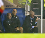 Walter Smith loses interest as the match draws to a conclusion