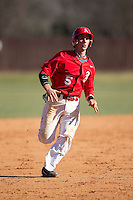 Drew Sipp (5) of the Belmont Abbey Crusaders hustles towards third base against the Shippensburg Raiders at Abbey Yard on February 8, 2015 in Belmont, North Carolina.  The Raiders defeated the Crusaders 14-0.  (Brian Westerholt/Four Seam Images)