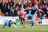 Lincoln City's John Akinde vies for possession with Stevenage's Joel Byrom<br /> <br /> Photographer Chris Vaughan/CameraSport<br /> <br /> The EFL Sky Bet League Two - Lincoln City v Stevenage - Saturday 16th February 2019 - Sincil Bank - Lincoln<br /> <br /> World Copyright © 2019 CameraSport. All rights reserved. 43 Linden Ave. Countesthorpe. Leicester. England. LE8 5PG - Tel: +44 (0) 116 277 4147 - admin@camerasport.com - www.camerasport.com