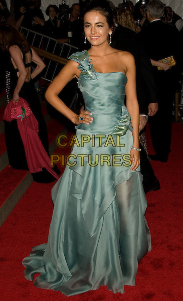 "CAMILLA BELLE.Costume Institute Gala - ""Superheroes: Fashion and Fantasy"" at The Metropolitan Museum of Art, New York, NY, USA..May 5th, 2008 .full length green dress gown one shoulder hand on hip.CAP/LNC.©TOM/LNC/Capital Pictures."