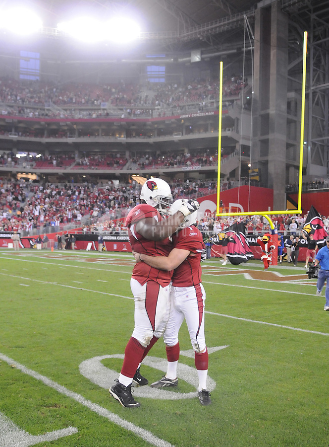 Dec. 23, 2007; Glendale, AZ, USA; Arizona Cardinals kicker Neil Rackers (right) is congratulated by guard Elton Brown after hitting the game winning field goal in overtime against the Atlanta Falcons at University of Phoenix Stadium. Arizona defeated Atlanta 30-27. Mandatory Credit: Mark J. Rebilas-US PRESSWIRE