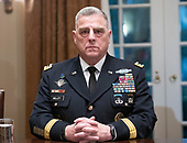 United States Army General Mark A. Milley, Chief of Staff of the Army listens as US President Donald J. Trump makes a statement to the media as he prepares to receive a briefing from senior military leaders in the Cabinet Room of the White House in Washington, DC on Tuesday, October 23, 2018.  The President took questions on the proposed space force, immigration, the caravan and Saudi actions in the killing of Jamal Khashoggi.<br /> Credit: Ron Sachs / Pool via CNP