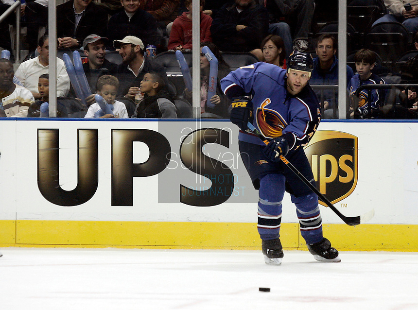 Atlanta Thrashers defenseman Greg de Vries passes in the second period against the Florida Panthers at Philips Arena. The Thrashers won the game 1-0.<br />