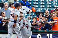 Detroit Tigers third baseman Miguel Cabrera (24) is greeted by autograph seeking fans before the MLB baseball game against the Houston Astros on May 3, 2013 at Minute Maid Park in Houston, Texas. Detroit defeated Houston 4-3. (Andrew Woolley/Four Seam Images).
