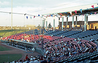 Ballparks: Adelanto, CA. Maverick's Stadium Grandstand. A very light crowd for a Mon. evening game, August 1999.