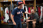 BOSTON, MA - APRIL 20: Daniel Glickman, 11, of Newton MA tugs on the beard of Mike Napoli #12 of the Boston Red Sox during a clubhouse tour at Fenway Park on April 20, 2014 in Boston, Massachusetts.  (Photo by Michael Ivins/Boston Red Sox/Getty Images) *** Local Caption ***Mike Napoli