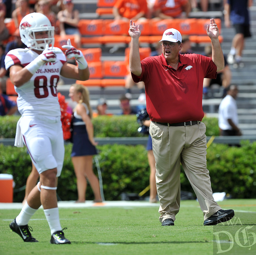 NWA Media/Michael Woods --08/30/2014-- w @NWAMICHAELW...University of Arkansas offensive coordinator Jim Chaney works with the team before the start of Saturday afternoons game against Auburn at Jordan-Hare Stadium in Auburn.