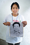 Tomasa Pacajoj holds a photo of her husband Pedro Morales Gonzalez during a vigil in Tapachula, Mexico, on December 17, 2013. The Maya K'iche'-speaking Guatemalan woman was part of a group of Central Americans who came to Mexico in search of family members who disappeared there, many while on their way north to the United States. The group, mostly mothers looking for their children, spent 17 days touring 14 Mexican states in search of their loved ones.<br /> <br /> Pacajoj says her husband left their home in Chichicastenango in 2007, and the last she heard from him was when he called from the Mexico-U.S. border to say he was about to cross the desert.