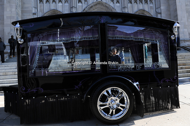 A young boy looks into the hearse of Tyshawn Lee, 9, who was shot multiple times while playing basketball in an alley on November 2, 2015, in Chicago, Illinois on November 10, 2015. Police allege the killing was a retaliatory gang hit which would mark a new turn in Chicago's gang wars.