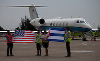 SANTA CLARA, CUBA - AUGUST 31 : Cuban workers hold a Cuban and U.S. flag before arriving the first commercial flight between the US and Cuba during the arrival of  inaugural flight at Abel Santamaría Airport on August 31, 2016 in Santa Clara, Cuba. Photo by VIEWpress