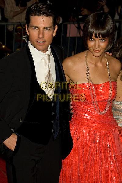 "TOM CRUISE & KATIE HOLMES.Costume Institute Gala - ""Superheroes: Fashion and Fantasy"" at The Metropolitan Museum of Art, New York, NY, USA..May 5th, 2008 .half length black suit red strapless dress gold necklace married husband wife .CAP/LNC.©TOM/LNC/Capital Pictures."