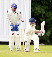 William Brookes is bowled by Mehul Gokhani during the ECB Middlesex Division Three game between Highgate and Harrow Town at Park Road, Crouch End on Saturday May 24, 2014