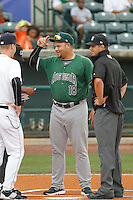 Augusta GreenJackets manager Nestor Rojas (18) meeting at the plate before a game against the Charleston Riverdogs at Joseph P.Riley Jr. Ballpark on April 15, 2015 in Charleston, South Carolina. Charleston defeated Augusta 8-0. (Robert Gurganus/Four Seam Images)