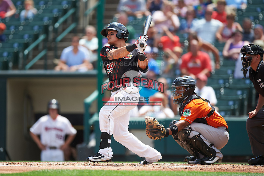 Rochester Red Wings third baseman Tommy Field (59) at bat in front of catcher Audry Perez (24) during a game against the Norfolk Tides on July 17, 2016 at Frontier Field in Rochester, New York.  Rochester defeated Norfolk 3-2.  (Mike Janes/Four Seam Images)