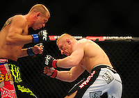 Oct. 29, 2011; Las Vegas, NV, USA; UFC fighter Dennis Siver (right) against Donald Cerrone during a lightweight bout during UFC 137 at the Mandalay Bay event center. Mandatory Credit: Mark J. Rebilas-