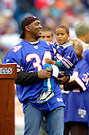 9 October 2005: Thurman Thomas (holding his son), former running back for the Buffalo Bills and 2006 Hall of Fame Candidate, is honored during halftime in a game between the Buffalo Bills and the Miami Dolphins. The Bills defeated the visiting division rival Dolphins 20-14 at Ralph Wilson Stadium, in Orchard Park, NY. ..Mandatory Photo Credit: Ed Wolfstein