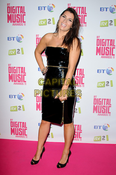 Grace Woodward.BT Digital Music Awards held at the Roundhouse, Chalk Farm, London, England..September 29th 2011.full length black strapless pvc hand on hip zip zipper smiling .CAP/CJ.©Chris Joseph/Capital Pictures.