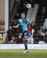 Will De Havilland of Wycombe Wanderers clears the ball during the Sky Bet League 2 match between Grimsby Town and Wycombe Wanderers at Blundell Park, Cleethorpes, England on 4 March 2017. Photo by Andy Rowland / PRiME Media Images.
