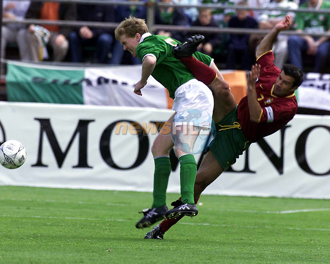 Portugals  No 7 Luis Figo attacking Rep of Irelands no 5 steve staunton during the Republic of Ireland V Partugal Qualifier in Dublin Ireland.Pic Fran Caffrey/Newsfile/AFP..Camera:   DCS620C.Serial #: K620C-01974.Width:    1152.Height:   1728.Date:  2/6/01.Time:   3:47:17.DCS6XX Image.FW Ver:   3.2.3.TIFF Image.Look:   Product.Sharpening Requested: No.Counter:    [17953].Shutter:  1/500.Aperture:  f7.1.ISO Speed:  400.Max Aperture:  f4.0.Min Aperture:  f22.Focal Length:  500.Exposure Mode:  Manual (M).Meter Mode:  Color Matrix.Drive Mode:  Continuous High (CH).Focus Mode:  Single (AF-S).Focus Point:  Center.Flash Mode:  Normal Sync.Compensation:  +0.0.Flash Compensation:  +0.0.Self Timer Time:  5s.White balance: Custom.Time: 03:47:17.526.