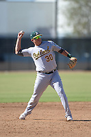 Oakland Athletics third baseman Ryon Healy (30) during an Instructional League game against the Milwaukee Brewers on October 10, 2013 at Maryvale Baseball Park Training Complex in Phoenix, Arizona.  (Mike Janes/Four Seam Images)