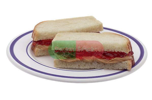 small plate with peanut butter and jelly sandwich on white bread on shadowless white background
