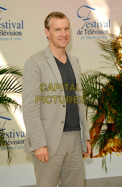 "TATE DONOVAN.Photocall promoting the television series ""Damages"" on the fourth day of the 2008 Monte Carlo Television Festival held at Grimaldi Forum, Monaco, Principality of Monaco..June 11th, 2008.half length 3/4 beige suit blue top .CAP/TTL .© TTL/Capital Pictures"